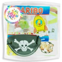 pirate themed party goodies bag for kids with sweets and eye patch.